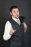 Explanation. Portrait of a man in a suit royalty free stock image