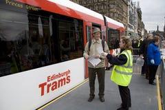 Explanation. Staff member explaining feature of new Edinburgh trams Stock Photography
