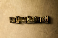 EXPLANATION - close-up of grungy vintage typeset word on metal backdrop Stock Photo