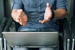 Explanation communication man hands gesticulate. Explanation and communication. man hands gesticulate in front of laptop stock photos