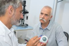 Explanation about eye disease to patient royalty free stock photo