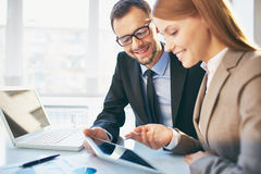 Explanation. Young businesswoman explaining report to her colleague at meeting royalty free stock images