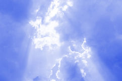 Explanatory note Clouds Image. Break through the clouds sun rays Stock Photography