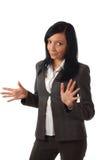 Explicación hermosa joven de la mujer de negocios Foto de archivo libre de regalías