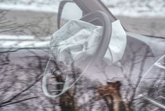 Exploded airbag in SUV car. Wrecked car with opened airbags royalty free stock image