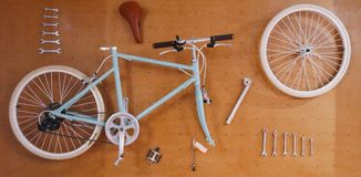Exploded bicycle and tool on the wall. Picture art Royalty Free Stock Photos