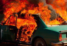 Exploded parking car on fire Stock Image