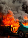 Exploded parking car on fire stock photography