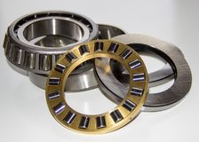 Exploded view of a thrust roller bearing and a tapered roller bearing. Isolated on white Stock Photos