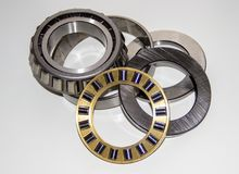 Exploded view of a thrust roller bearing and a tapered roller bearing. Isolated on white Royalty Free Stock Image