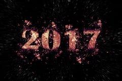 Exploderende inschrijving 2017 op een zwarte achtergrond Stock Foto