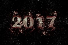 Exploderende inschrijving 2017 op een zwarte achtergrond Stock Fotografie