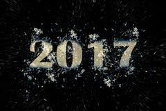 Exploderende inschrijving 2017 op een zwarte achtergrond Stock Foto's