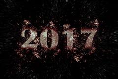 Explodierende Aufschrift 2017 auf einem schwarzen Hintergrund Stockfotografie