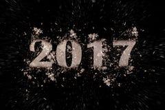 Explodierende Aufschrift 2017 auf einem schwarzen Hintergrund Stockbilder