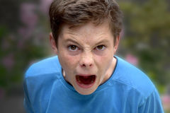 Exploding with anger. Teenager boy  exploding with anger