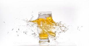 Exploding Beer Glass. Glass of beer exploding. Against a white background royalty free stock image