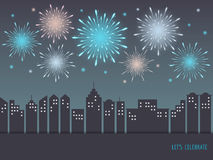 Exploding colorful fireworks over cityscape. Exploding colorful fireworks display on night sky over cityscape, buildings. Fireworks for carnival, celebration Royalty Free Stock Photography