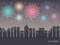 Exploding colorful fireworks over cityscape. Exploding colorful fireworks display on night sky over cityscape, buildings. Fireworks for carnival, celebration Stock Image