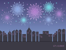 Exploding colorful fireworks over cityscape Royalty Free Stock Photo