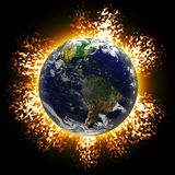 Exploding Earth. Illustration of an exploding planet earth or asteroid collision against the globe.  Earth image courtesy of NASA Royalty Free Stock Image