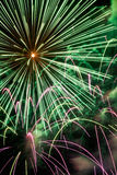 Exploding Firework Display in Green and Pink Colors Royalty Free Stock Photos