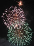 Exploding fireworks. Colorful fireworks exploding in night sky royalty free stock images