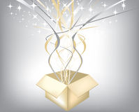 Exploding gift with silver and gold hearts Stock Images