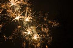 Exploding Golden Stars Stock Image