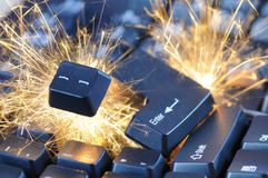 Exploding keyboard. Black exploding computer keyboard with electric sparks royalty free stock image