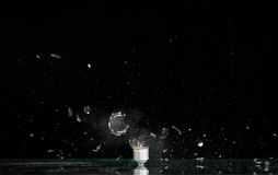 Exploding lamp bulb. High speed photography of an exploding lamp bulb Royalty Free Stock Image