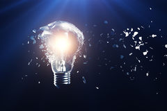 Exploding light bulb on a blue background, with concept creative thinking and innovative solutions. 3D rendering. Exploding light bulb on a blue background, with Royalty Free Stock Photography