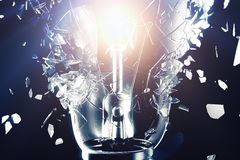 Exploding light bulb on a blue background, with concept creative thinking and innovative solutions. 3D rendering. Exploding light bulb on a blue background, with Royalty Free Stock Photos