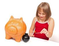 Exploding piggy bank Stock Photo