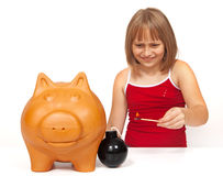 Exploding the piggy bank Royalty Free Stock Photography