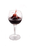 Exploding red wine. Explosion of a red wine shot against white background Royalty Free Stock Photo