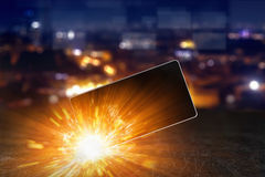 Exploding smartphone, overheating battery cells. Smartphone battery explosion, exploding mobile phone, overheating battery cells stock photography
