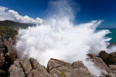 Exploding surf at Pancake Rocks of Punakaiki, NZ. Surf of Tasman Sea exploding in blowhole in pancake rocks at Punakaiki, South Island, New Zealand, pushing Royalty Free Stock Photography