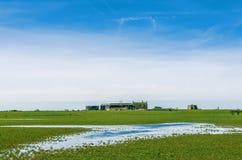 Exploração agrícola e abadia de Cockersand com campos inundados Fotos de Stock Royalty Free