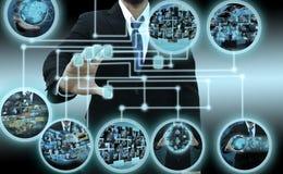 Exploração do homem de negócios de um dedo em um ecrã táctil imagens de stock royalty free