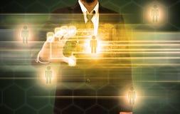Exploração do homem de negócios de um dedo em uma relação do tela táctil imagens de stock royalty free