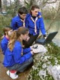 Exploradores con la computadora portátil Fotografía de archivo