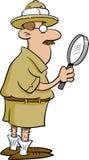 Explorateur retenant une loupe Image libre de droits