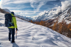 Exploration. Concept: a lonely hiker in the wilderness. Mont Blanc massif, Val Ferret, Courmayeur, Valle d'aosta, Italy stock photography