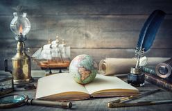 Free Exploration And Nautical Theme Grunge Background. Globe, Telescope, Divider, Old Coins, Shell, Map, Book, Hourglass, Quill Pen On Royalty Free Stock Photo - 146689655