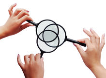 Exploration with magnifiers. Magnifiers and three women hands stock photography