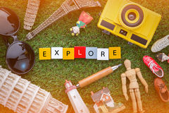 Explore concept with souvenirs around the world on green grass Royalty Free Stock Photos