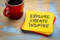 Explore, create, inspire concept on napkin. Explore, create, inspire reminder on sticky note  with a cup of coffee Royalty Free Stock Photos