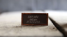 Explore Dream Discover idea. Explore Dream Discover - Inspirational Travel Quote, text and vintage table stock video footage