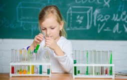 Future scientist. Explore and investigate. School lesson. Interesting approach to learn. Girl cute school pupil play. Explore and investigate. School lesson royalty free stock photo